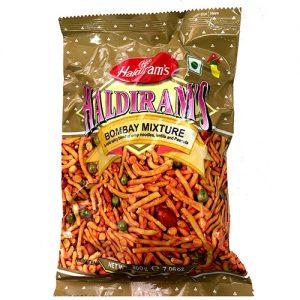 רק במהרג'ה בומביי מיקס (BOMBAY MIXTURE)– מסדרת החטיפים ההודיים של מהרג'ה! חטיף הודי אותנטי, על בסיס קמח חומוס, צ'נה דל, בוטנים, אפונה ירוקה ותבלינים.
